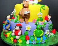 Estatuillas animales de la pasta de azúcar - detalles de la torta Imagen de archivo