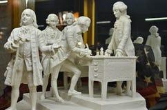 Estatuillas de mármol talladas con Ben Franklin Foto de archivo