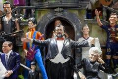 Estatuillas hechas a mano y gente pintada, famosa foto de archivo