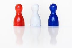 Estatuillas rojas, blancas, azules del juguete Foto de archivo libre de regalías