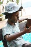 Estatuto de acero del muchacho Fotos de archivo libres de regalías