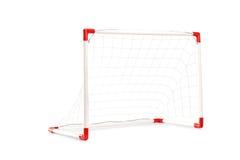 Estúdio disparado de um objetivo pequeno do futebol Fotos de Stock