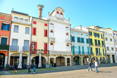 Este, Italy, 22 Apr 2017 - people walk under the colorful buildi. Ngs in  the main street of the italian Este village, province of Padua Royalty Free Stock Images