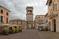 Este, Italy August 24, 2018: the clock tower on the main square in Este. royalty free stock image