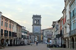 Street cafes and Town Gate with ornamental clock tower, Este, Veneto, Italy stock images