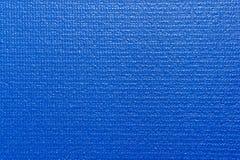 Esteira azul da ioga Fotos de Stock Royalty Free