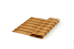 Esteira de bambu com fotos de stock