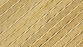 Esteira de bambu da rotação, textura do fundo para o projeto filme