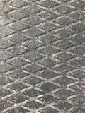 Esteira de borracha industrial suja com teste padrão do rombo de а fotos de stock