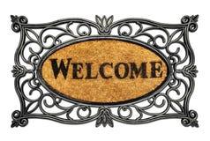 Esteira de porta bem-vinda amigável fotos de stock royalty free