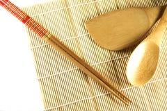 Esteira e chopsticks do rolamento Fotografia de Stock Royalty Free