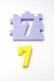 Esteiras do enigma do número sete. Foco no dianteiro (DOF pequeno) Foto de Stock