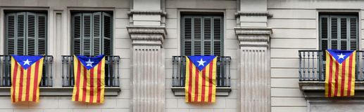 Estelada, the Catalan separatist flag. In the windows of an house in Barcelona Stock Photography