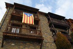 Estelada flag in a building in Catalonia. TAVASCAN, SPAIN - DECEMBER 07, 2017: Building with `estelada` flag in the balcony, claiming the independecia for Royalty Free Stock Photos