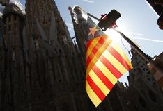 The Estelada the flag pro independence of Catalonia. Waving in front of the Sagrada Familia of Gaudi, in Barcelona Royalty Free Stock Image