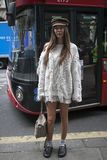 Estelle Pigault wearing a white knit, Chloe bag, slippers, socks, flat cap during London Fashion Week September 2017 outside Eudon Stock Photos
