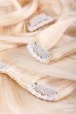 Estensione dei capelli biondi Fotografia Stock