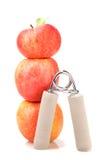 Estensore carpale e una pila di tre mele rosse Fotografie Stock Libere da Diritti