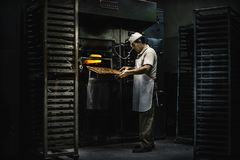Manufacturing plant of handmade `Mantecados y Polvorones`, typical Spanish Christmas sweet. Estepa, Sevilla, Spain - December 15, 2018: Manufacturing plant of stock photography