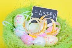 Ester eggs in nest with copy-space blackboard Stock Photo