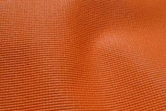 Estera de goma anaranjada imagen de archivo