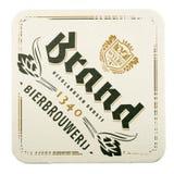Estera de la cerveza de la marca aislada en el fondo blanco Fotografía de archivo libre de regalías