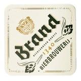 Estera de la cerveza de la marca aislada en el fondo blanco Fotos de archivo
