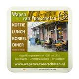 Estera de la cerveza que hace publicidad del café de Wapen van Voorschoten Imágenes de archivo libres de regalías