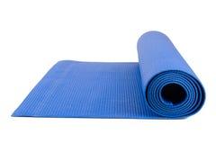 Estera de la yoga para el ejercicio Foto de archivo