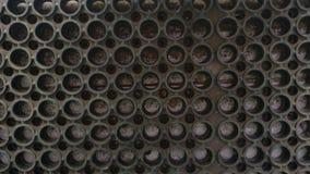 Estera negra con los agujeros Foto de archivo libre de regalías