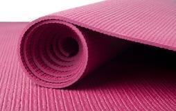 Estera rosada de la yoga Foto de archivo libre de regalías