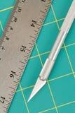 Estera y cuchillo del corte Fotos de archivo libres de regalías