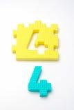 Esteras del rompecabezas del número cuatro. Foco en el delantero (pequeño DOF) Foto de archivo libre de regalías