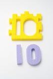 Esteras del rompecabezas del número diez. Foco en el delantero (pequeño DOF) Foto de archivo libre de regalías