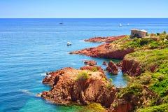 Esterel rocks beach coast and sea. Cote Azur, Provence, France. Esterel mediterranean red rocks coast, beach and sea. French Riviera in Cote d Azur near Cannes stock images