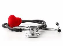 Estetoscópio com coração em um branco Imagens de Stock