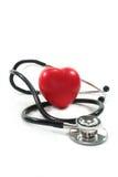 Estetoscópio com coração vermelho imagem de stock