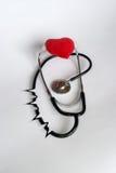 Estetoscópio com coração vermelho Foto de Stock Royalty Free
