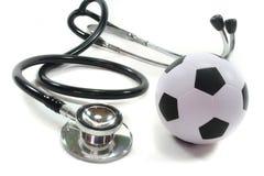 Estetoscópio com futebol imagem de stock