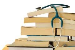 Estetoscópio com livros de texto Fotografia de Stock