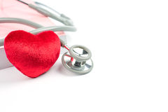 Estetoscópio, coração vermelho e livro Foto de Stock