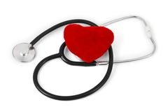 Estetoscópio e coração Imagens de Stock