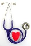 Estetoscópio e coração vermelho Imagem de Stock