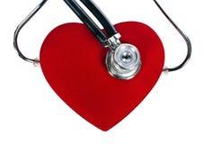 Estetoscópio e coração vermelho de um doutor Imagens de Stock