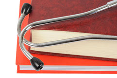 Estetoscópio em livros Fotografia de Stock
