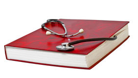 Estetoscópio médico no livro vermelho. Imagem de Stock Royalty Free