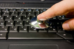 Estetoscópio no teclado imagens de stock royalty free