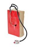 Estetoscopio en el libro viejo rojo Imagen de archivo libre de regalías