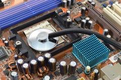 Estetoscopio en mainboard del ordenador Fotos de archivo libres de regalías