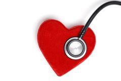 Estetoscopio en un corazón rojo Fotografía de archivo